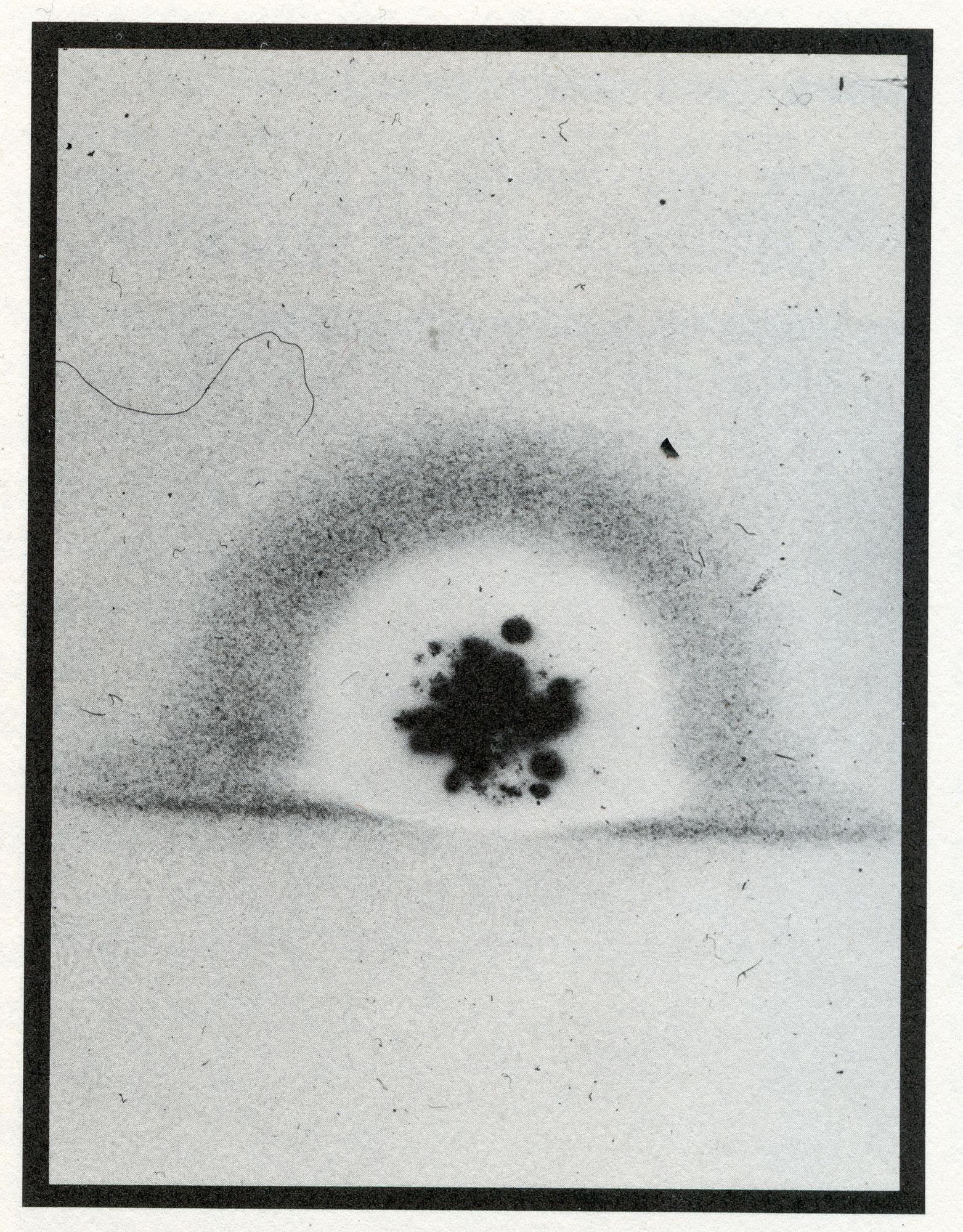 Trinity blast with burn hole in film
