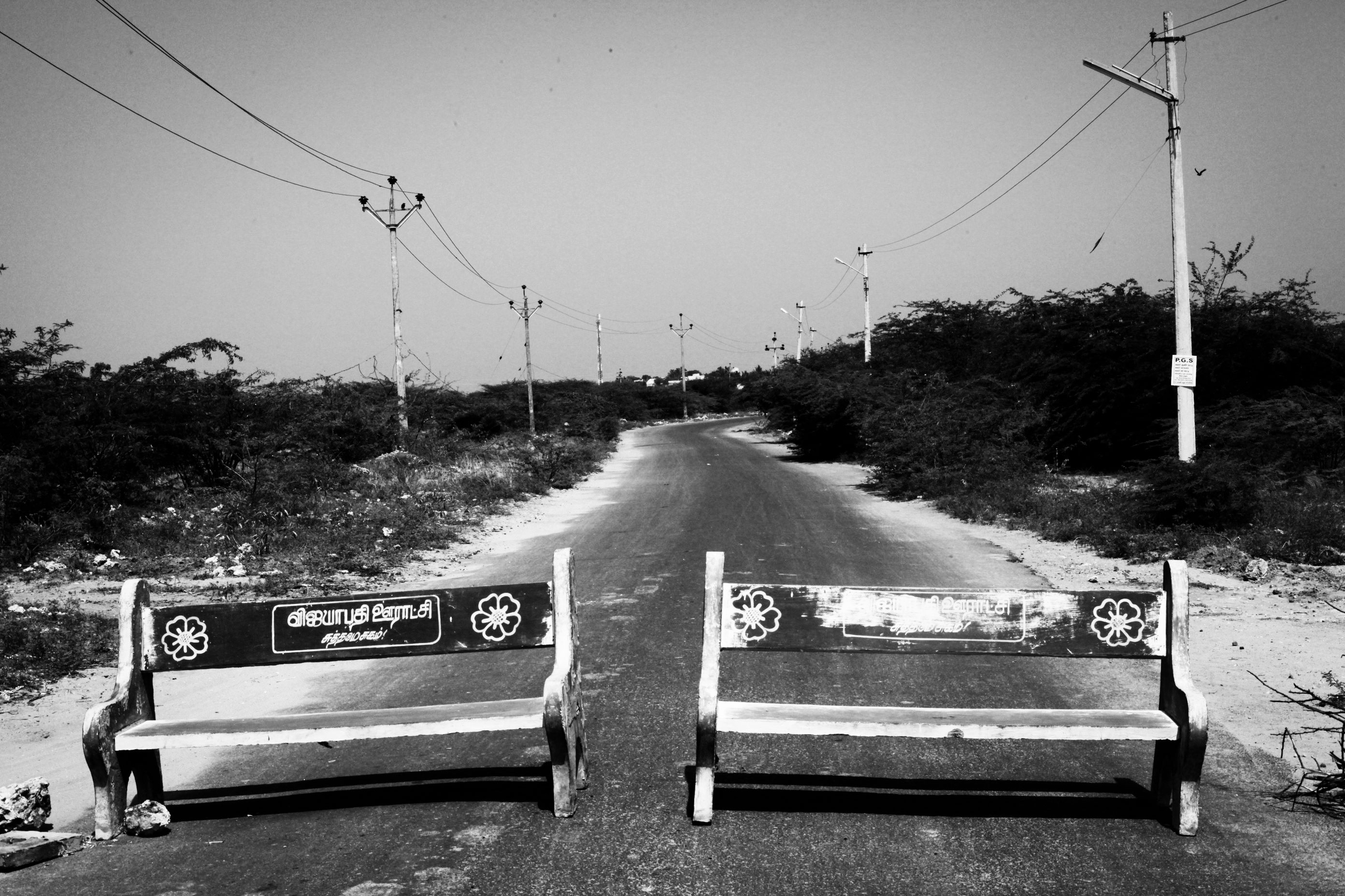 Concrete benches form a blockade on a road that leads to Idinthakarai village. Blockades like these are used by protesting villagers to slow down the vehicular movements of forces approaching from outside the settlements, and to gain time to assemble in masses.