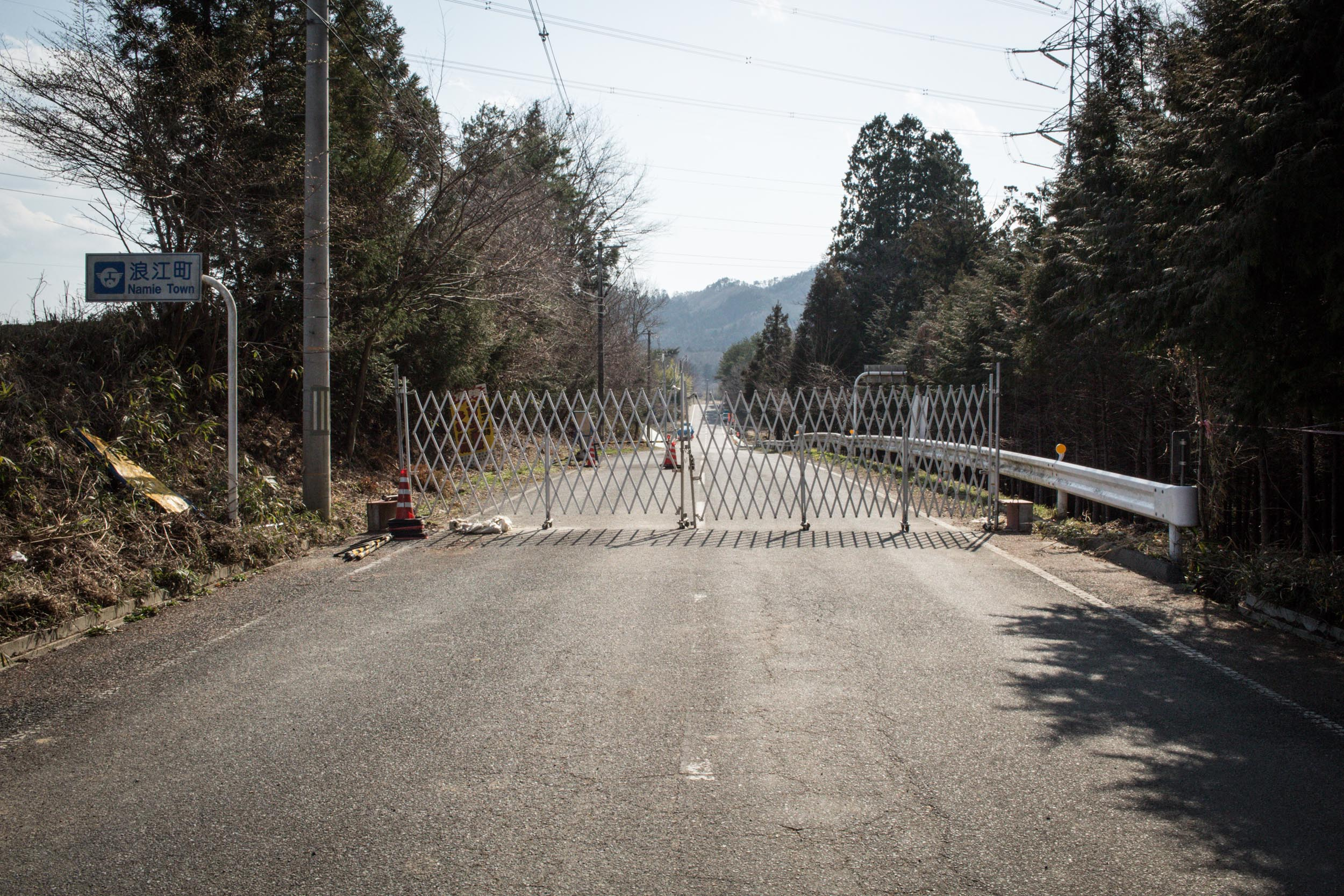 Roads blocked at the entrance of Namie town. Namie had a population of 21,000 at the time of the nuclear accident and falls within the range of 4 to 20 miles exclusion radius around the damag