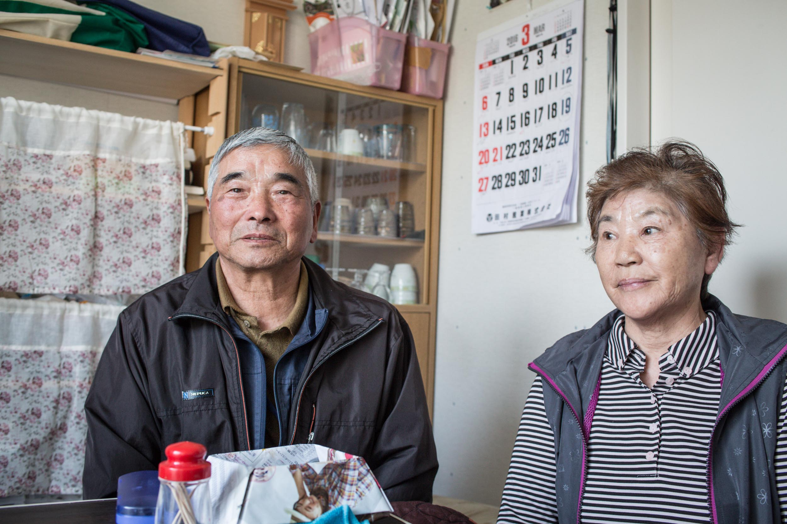 Suzuki Hideji and his wife Toshiko, who were evacuated from Komiya and have rehabilitated in a temporary housing. Mr Suzuki says he cannot go back to those good days. Many people are suffering from sickness due to the stress of being rehabilitated in temporary shelters and not being able to return to normal life.