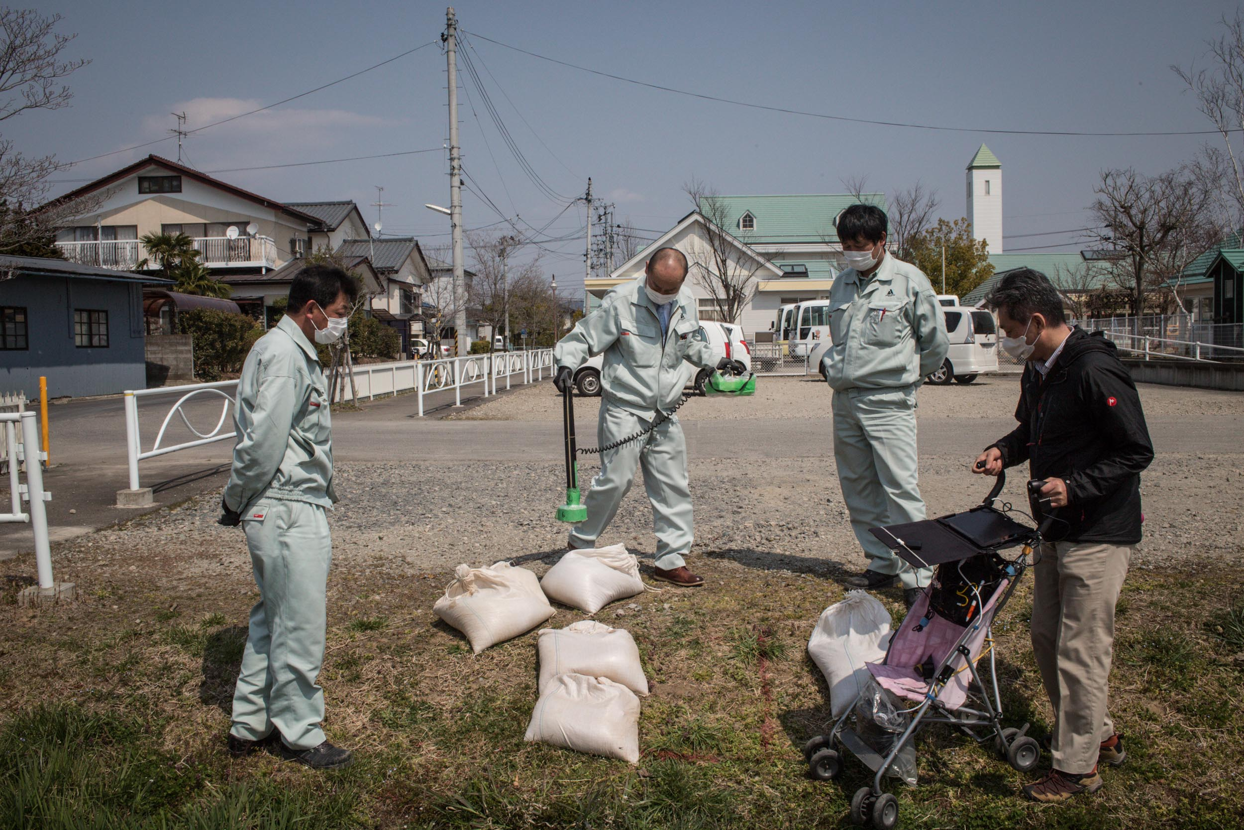 Decontamination workers checking for radioactive contamination at Lumbini Kindergarten at Fukushima City which is 64km away from the Fukushima Daichii nuclear power plant.